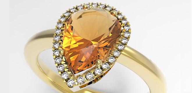 Render dell'anello con pietra a goccia e giro di diamanti